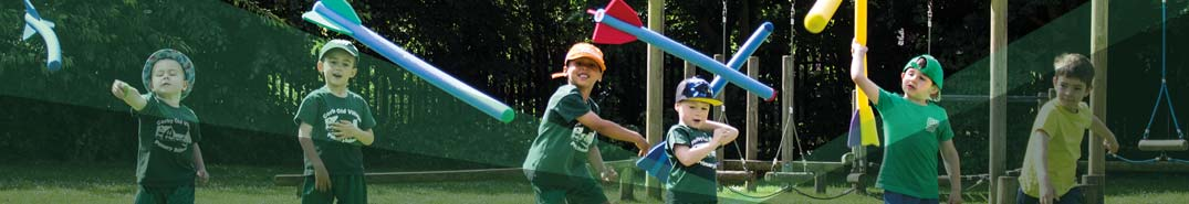 A group of boys throwing javelins