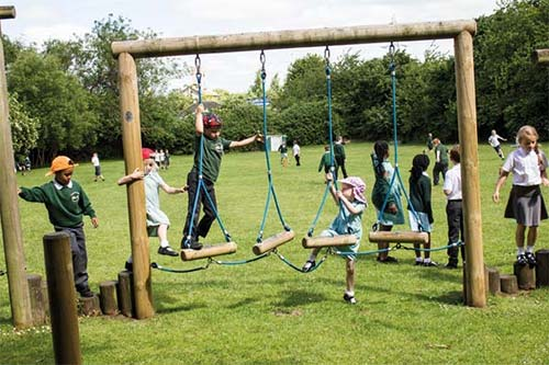 A group of children playing on a climbing frame
