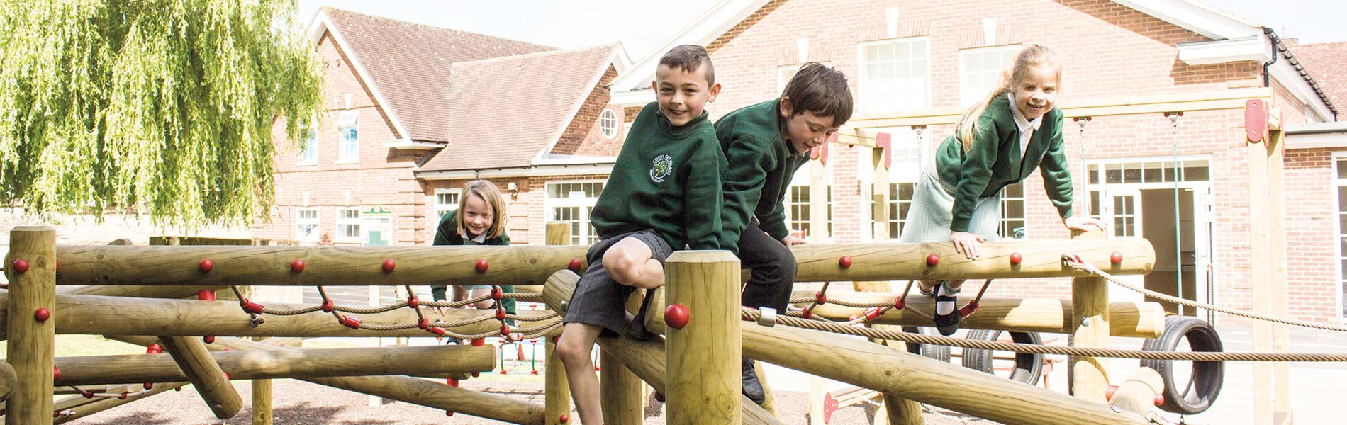 Pupils on climbing frame at Corby Old Village Scholl