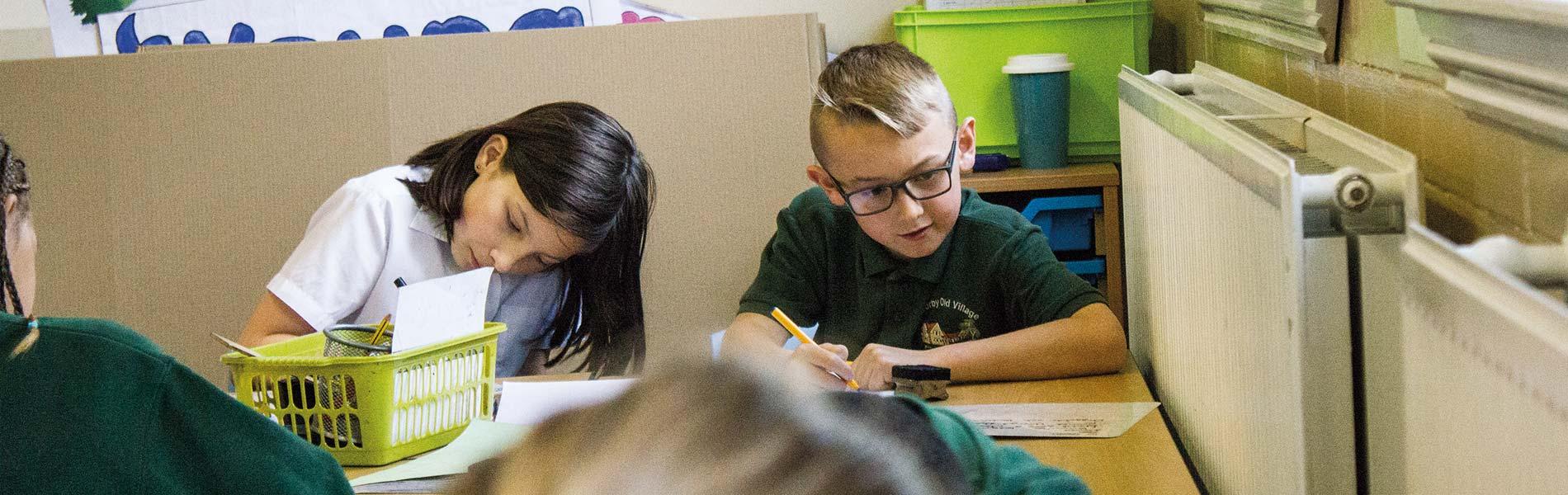 Pupils working hard together