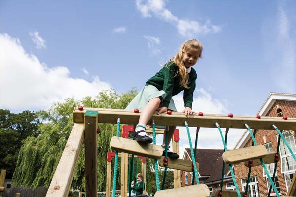 A child playing on a climbing frame