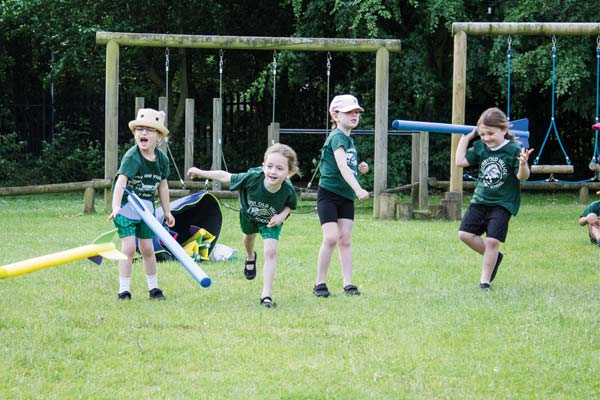 Children throwing javelins in Corby Old Village Primary School PE Kit