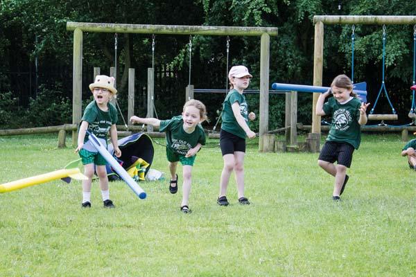 Children throwing javelins in Corby Old Village Primary School PE Kit