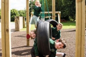 Children smiling playing on the playground