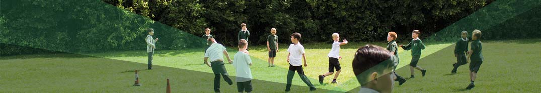 A group of children playing football on the field